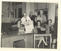 Women with typewriters and men holding the Daily Southerner
