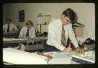 Men working at desks