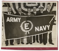 """Military and Firestone Representatives Holding Army-Navy """"E"""" production Award Banner"""
