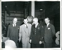 Military and Civilian Officials Examine Wartime Products