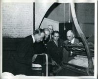 Military and Civilian Officials on Mill Floor