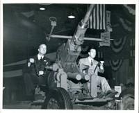 Civilian Men Seated at Anti-Aircraft Gun