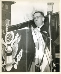Military Officer Speaking in Front of Firestone Mill