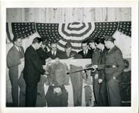 Group Examining Display of Military Uniforms