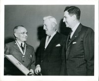 Military Officer Presents Medals to Firestone Executives