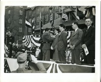 """Pinning Army-Navy """"E"""" production Awards at Firestone Mills"""